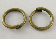 Antique Bronze Closed but Unsoldered Jump Rings 7x0.7mm sold per ounce 829x