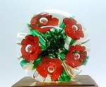 SOLD     1987 Gibson Studio Paperweight Ruby Red Flowers on Green Frit